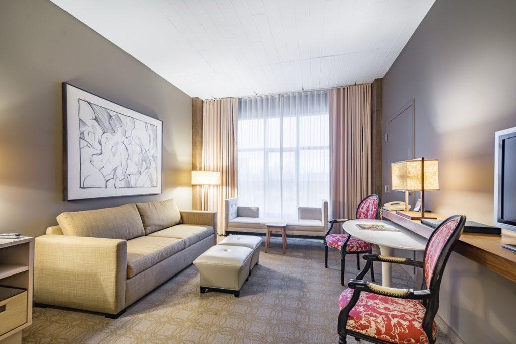 Loft King Living Area at Proximity Hotel