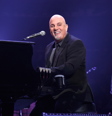 Billy Joel playing the piano