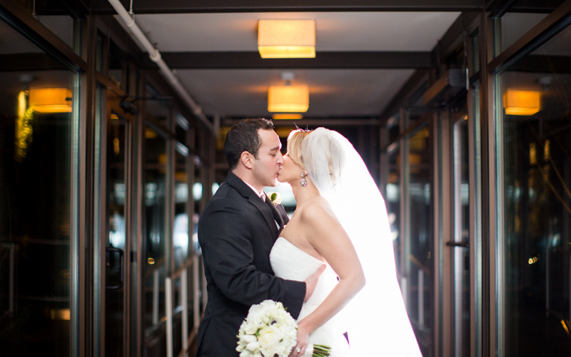 Gatsby Winter Wedding at Proximity Hotel, Bride and Groom Kiss