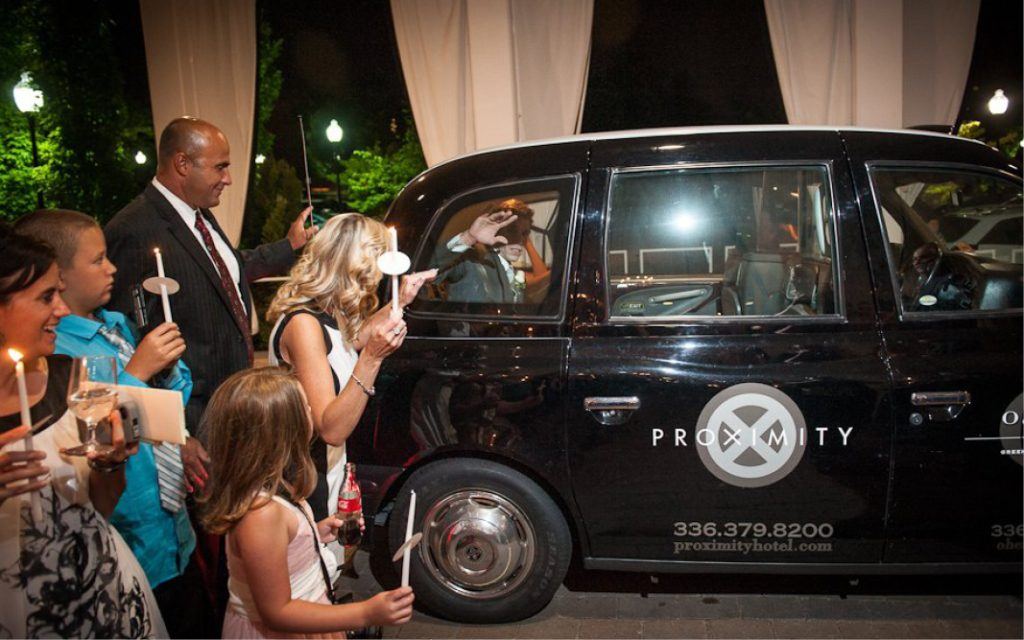 Proximity Hotel Wedding, Molly and Neil, bride and groom in london taxi