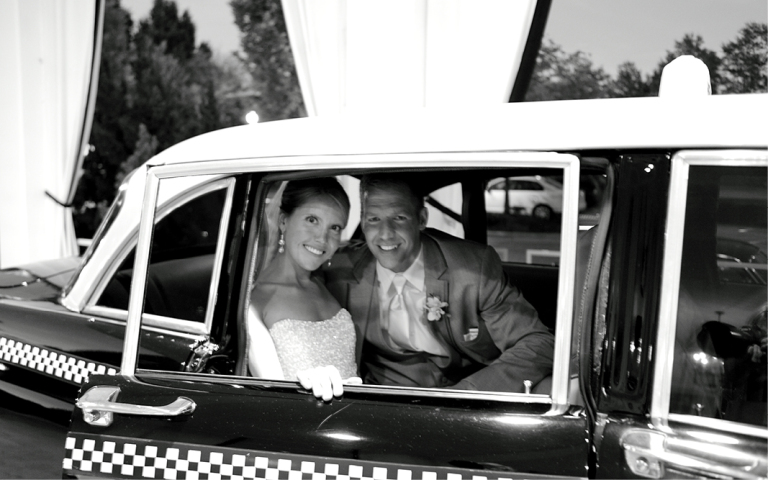 Proximity Hotel Wedding, Whitney and Dustin, bride and groom in checkered cab